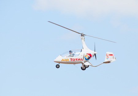 airshow: CLEETHORPES, ENGLAND JULY 27TH: A Gyrocopter performs an aerobatic display at Cleethropes airshow on 27th July 2014 in Cleethorpes England.