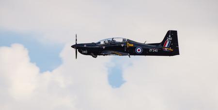 airshow: CLEETHORPES, ENGLAND JULY 27TH: Royal Air Force Tucano performs  an aerobatic display at Cleethropes airshow on 27th July 2014 in Cleethorpes England. Editorial