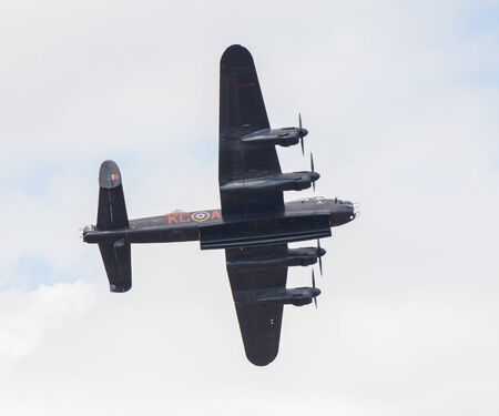 CLEETHORPES, ENGLAND JULY 27TH: Lancster Bomber from Battle of Britain Memorial flight performs a fly past Cleethropes airshow on 27th July 2014 in Cleethorpes England.
