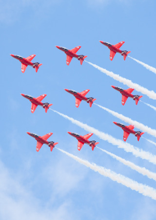 CLEETHORPES, ENGLAND JULY 27TH: Royal Air Force Red arrows perform an aerobatic display at Cleethropes airshow on 27th July 2014 in Cleethorpes England.