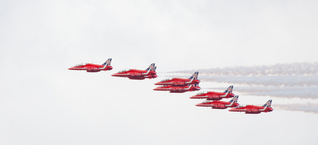 aerobatic: CLEETHORPES, ENGLAND JULY 27TH: Royal Air Force Red arrows perform an aerobatic display at Cleethropes airshow on 27th July 2014 in Cleethorpes England.