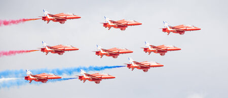 royal air force: CLEETHORPES, ENGLAND JULY 27TH: Royal Air Force Red arrows perform an aerobatic display at Cleethropes airshow on 27th July 2014 in Cleethorpes England.