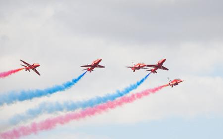 airshow: CLEETHORPES, ENGLAND JULY 27TH: Royal Air Force Red arrows perform an aerobatic display at Cleethropes airshow on 27th July 2014 in Cleethorpes England.
