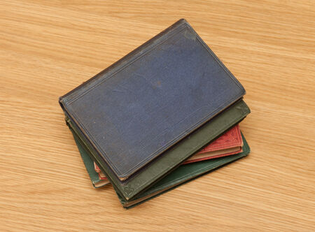Pile of very old books on desk photo