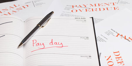 monthly salary: Pay day loan concept shot Stock Photo