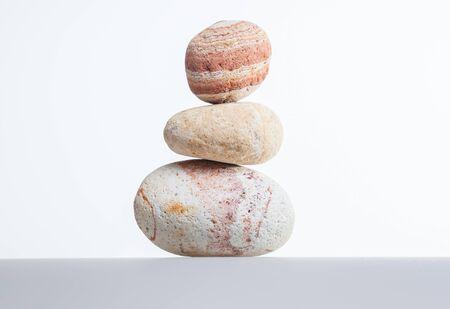 balanced rocks: Pile of stones on a white background