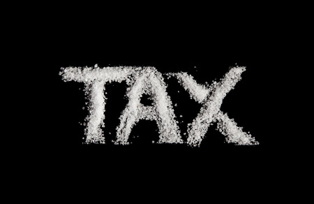 The word tax spelt out in sugar to represent sugar tax
