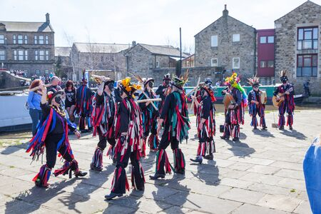 morris: SKIPTON ENGLAND APRIL 6TH: Morris dancers put on a public display with dancing in Skipton on 6th April 2015 in Skipton England.