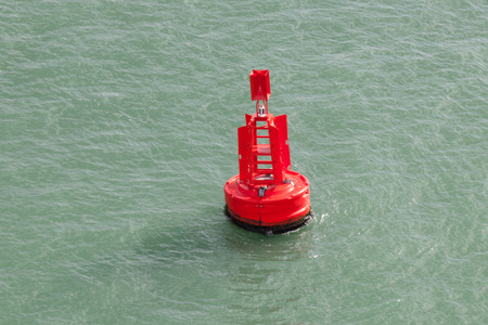 Red Bouy in the ocean Stock Photo