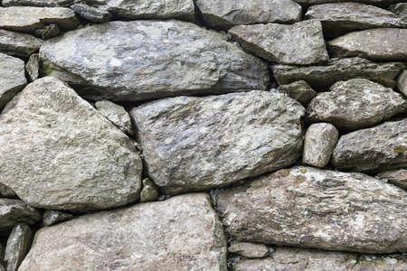 overbuilding: Stone wall background picture shot Archivio Fotografico
