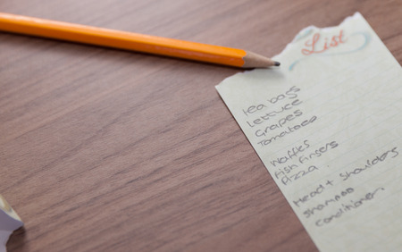 checking ingredients: shopping list on wood ackground shot Stock Photo