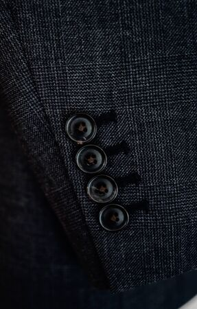 cuff buckle: close up of a business suit button detail
