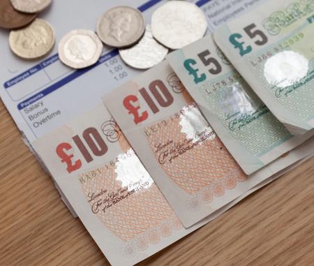 paycheck: Payslip and money close up shot