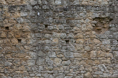 overbuilding: Old stone wall background shot