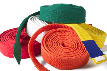 white back ground: colored Karate belts on a white back ground Stock Photo