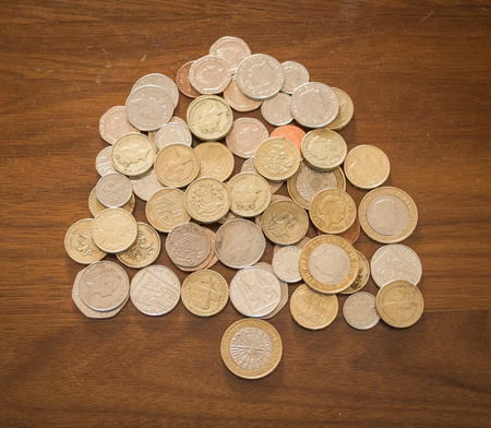 money on a table in shape of a tree Stock Photo