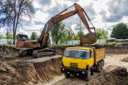 dumper truck: Loading soil into a dumper truck