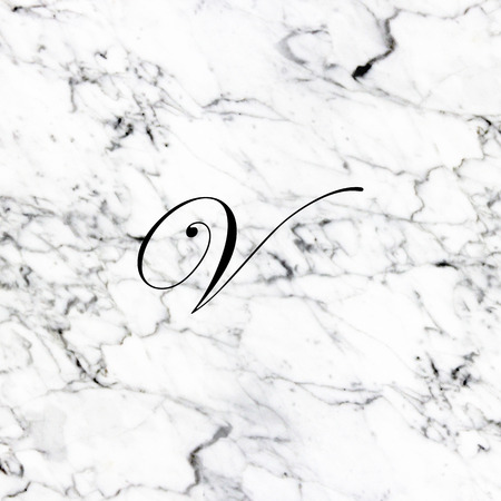 Abstract natural marble texture and alphabet V Banque d'images