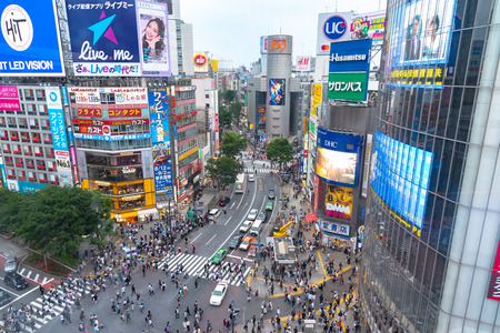 Shibuya, Tokyo, Japan - April 30, 2018: Pedestrians crosswalk at Shibuya district in Tokyo, Japan. Shibuya Crossing is one of the busiest crosswalks in the world.