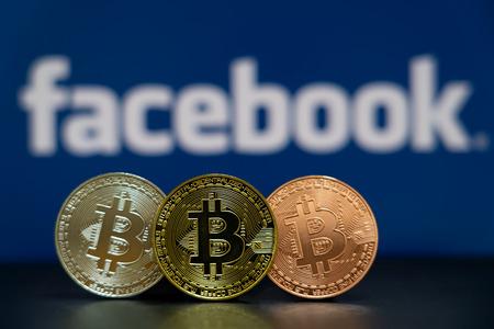 Bitcoin coin with the Facebook logo screen background