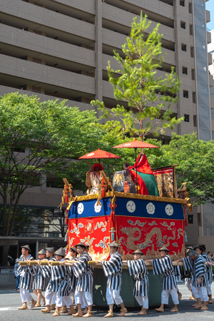 Gion Matsuri Festival, the most famous festivals in Japan. Participants in traditional clothing pulling a highly decorated huge float in the parade.