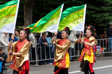 YOSAKOI Soran Festival. Powerful dance performances parade in Odori Park, Sapporo City. Many teams showcase the original dance. A very popular festival for tourists.
