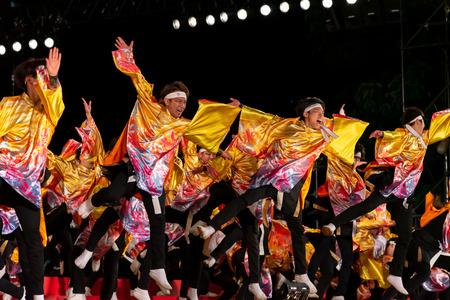 YOSAKOI Soran Festival. Powerful dance performances parade in Odori Park, Sapporo City. Many teams showcase the original dance. A very popular festival for tourists. Editorial