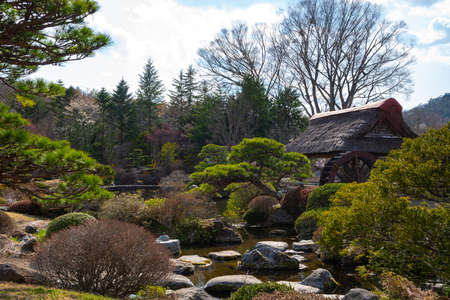Traditional House, Spring Garden at ancient Oshino Hakkai village near Mt. Fuji, Fuji Five Lake region, Minamitsuru Distri CT, Yamanashi Prefecture, Japan.