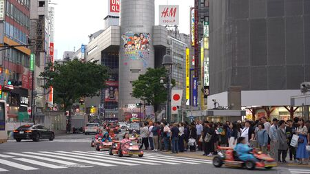 Mario Kart running on Shibuya Crossing. Tourist Rent a Go-kart can drive on Shibuya District, Harajuku and Omotesando all the famous shopping and sightseeing spot . Tokyo, Japan