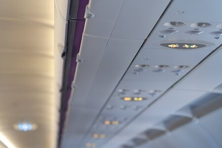 Fasten seat belt and no smoking signs in aircraft, overhead console of conditioner in a airplane. signs in the plane.