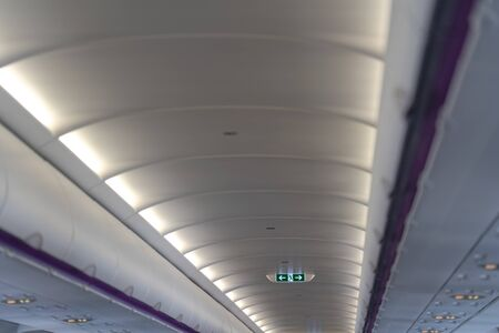 EXIT Lightbox signage on airplane, escape way of life. Concept Way to survive Standard-Bild