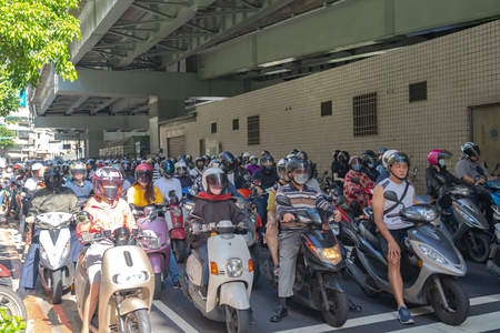 Taipei, Taiwan : 21 June 2019, Scooter waterfall in Taiwan. Traffic jam crowded of motorcycles at rush hour on the ramp of Taipei Bridge, Cascade of scooters on Minquan West Road in Datong District Editorial