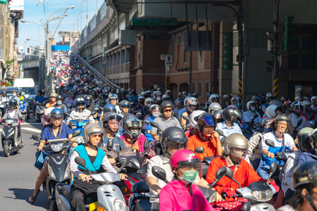 Taipei, Taiwan : 21 June 2019, Scooter waterfall in Taiwan. Traffic jam crowded of motorcycles at rush hour on the ramp of Taipei Bridge, Cascade of scooters on Minquan West Road in Datong District.
