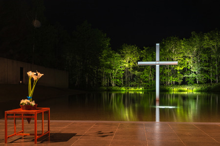Church on the Water or Chapel on the Water, a large window faces a reflecting pool. design by Japanese modernist architect Ando Tadao. Hoshino Resort Tomamu, Shimukappu, Hokkaido, Japan