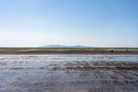 Lake Hachirogata, view from JR Tohoku Ou Main Line train, Akita, Japan