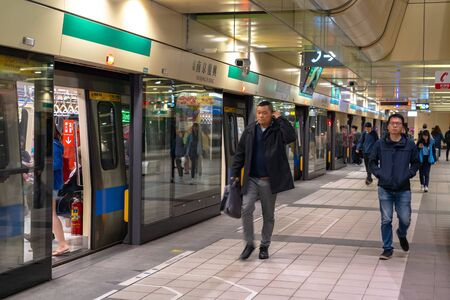 Taipei metro station hall and platform. Subway passengers walk through the enormous underground network of the Taipei Metro system. Editorial