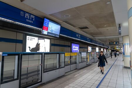 Taipei metro station hall and platform. Subway passengers walk through the enormous underground network of the Taipei Metro system.