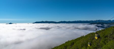 Panorama view from Unkai Terrace in summer time sunny day. Take the cable car at Tomamu Hoshino Resorts, going up to see the sea of clouds. Shimukappu village, Hokkaido, Japan 版權商用圖片
