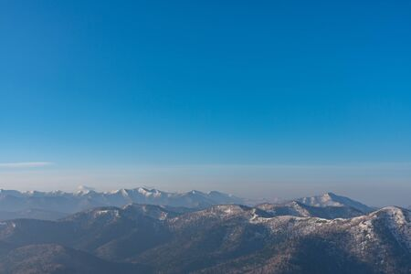 Panoramic view of beautiful mountain landscape, snowy mountain peaks covered by forest with a dark blue clear sky backgrou nd in spring time sunny day 版權商用圖片