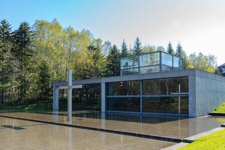 Church on the Water or Chapel on the Water, a large window faces a reflecting pool. design by Japanese modernist architect Ando Tadao. Hoshino Resorts Tomamu, Shimukappu, Hokkaido, Japan