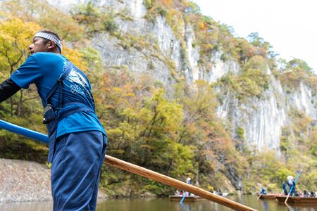 Boatman of Geibikei Gorge River Cruises. Geibikei Gorge is famous for boat ride, with a great view of waterfalls, impressive rocks, cave, etc. Ichinoseki, Iwate Prefecture, Japan