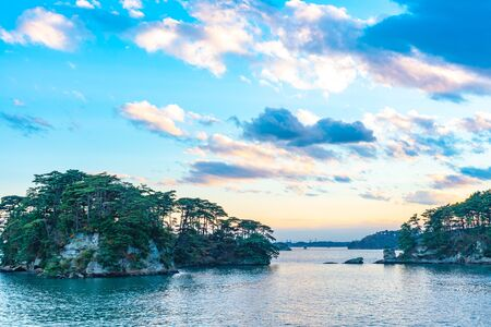 Matsushima Bay in dusk, beautiful islands covered with pine trees and rocks. One of the Three Views of Japan, and is also the site of the Zuigan-ji, Entsu-in and Kanrantei. in Miyagi Prefecture, Japan