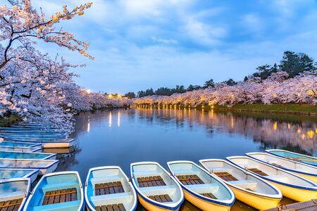 Hirosaki Park Cherry Blossoms Matsuri Festival in Springtime Season. Beauty full bloom pink sakura flowers light up at night in west moat. Aomori Reflection Region, Japan Stockfoto