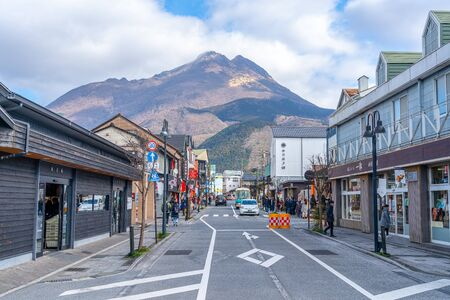Townscape of Yufuin in Winter Sunny Day with Clear Blue Sky. Many Shops on the Street, Tours Come Here for Sightseeing in New Year Holidays. Yufuin, Oita Reflection, Japan