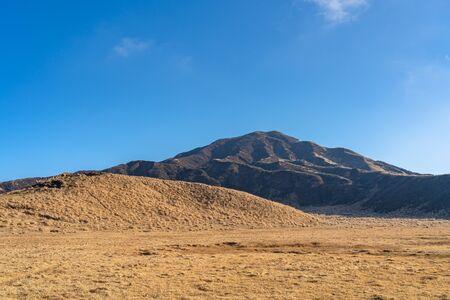 Kusasenri (kusasenri-ga-hama) prairie in January, Mt. Eboshi in the background. Aso Kuju National Park, Kumamoto Prefecture, Japan