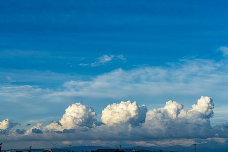 Vast white cumulus clouds with blue sky background Stock Photo
