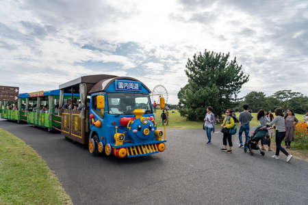 Tourists riding the Seaside Train around the Hitachi Seaside Park. Ibaraki Prefecture, Japan.