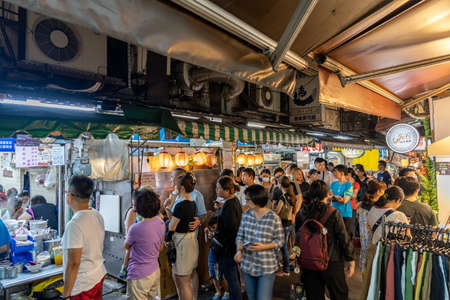 Fengyuan Miao Tung Night Market, famous travel destination. People can seen walking and exploring around it. Big part of Taiwanese culture. Fengyuan District, Taichung city, Taiwan Stock fotó - 151820695