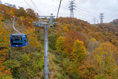 Dragondola (Naeba-Tashiro Gondola) in autumn foliage season. The longest aerial gondola lift line Japan. Naeba, Yuzawa, Niigata Prefecture, Japan