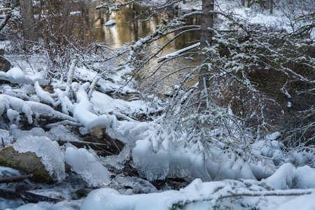Icy creek flowing in winter season. Grassi Lakes, Canmore, Alberta, Canada. Stock fotó